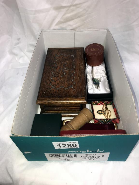 A box of miscellaneous including pill boxes, tie clips,