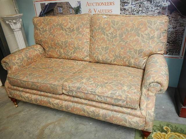A two seater sofa.