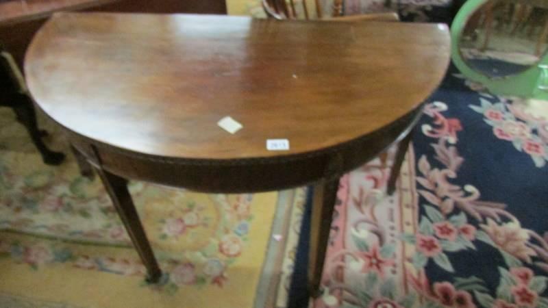 A D shaped mahogany table.