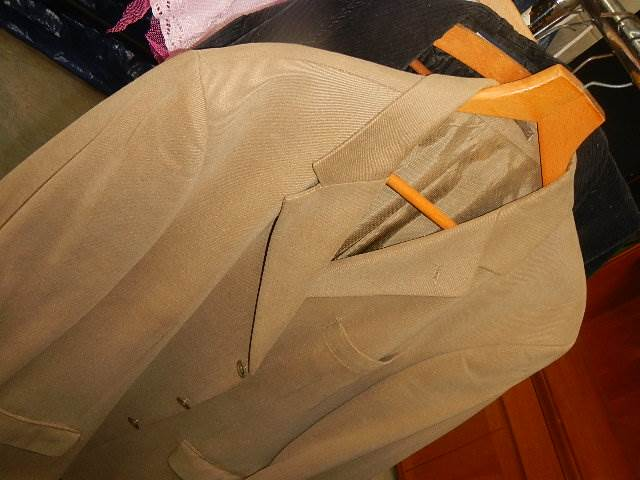 A rail of assorted suits, jackets and other clothing. - Image 8 of 11