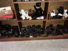 A large lot of carved wooden elephants,