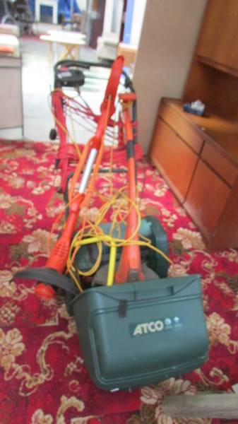 An ATCO lawn mower and 2 strimmers.
