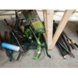 A quantity of electric garden tools and a flat pack wheel barrow.