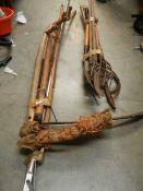 A quantity of garden tools including scythe.