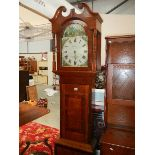An oak cased grandfather clock by W Farnhill, Rotherham.