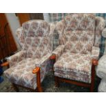 A pair of wing arm chairs.