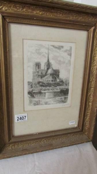 """A framed and glazed engraving """"Notre Dame Du Paris""""."""