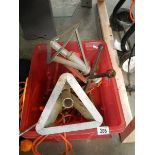 A box containing car axle stands.