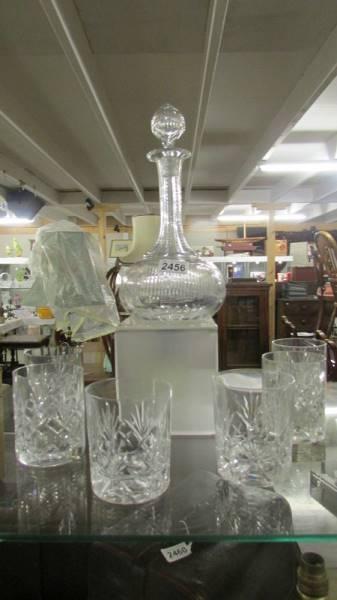 A cut glass decanter and six glasses.