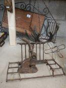 A mixed lot of metal ware including woodpecker door knocker, horse shoe hanging basket etc.