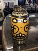 A West German pottery lava vase, circa 1950 / 1960's, mustard glaze, height approximately 38cm.