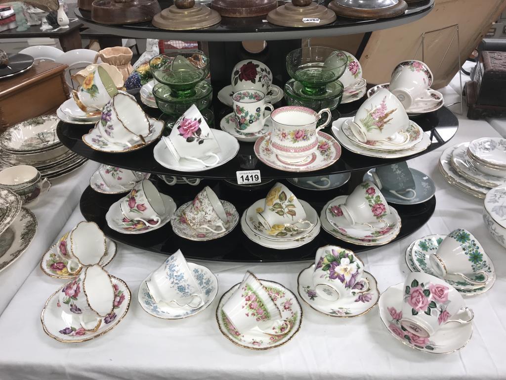A quantity of porcelain trio's & cups & saucers including Royal Albert etc.