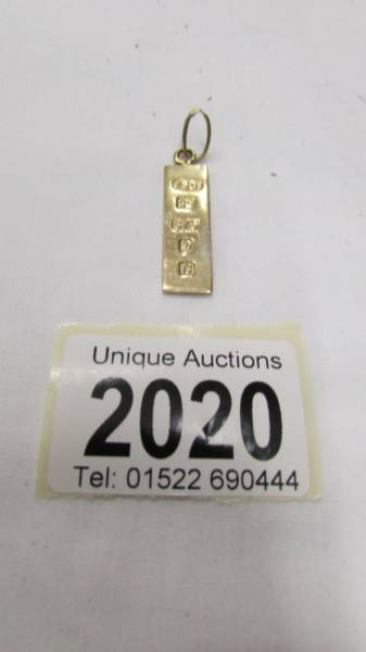 A 9ct gold hall marked ingot, 3.8 grams.