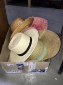 A quantity of vintage hats including straw boater etc.