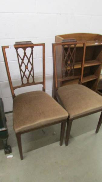 A pair of mahogany inlaid chairs.