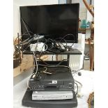 A television on stand with video and DVD player, in working order.