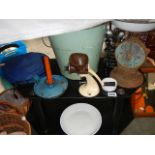 An enamel bucket, TV table and old kitchen items.