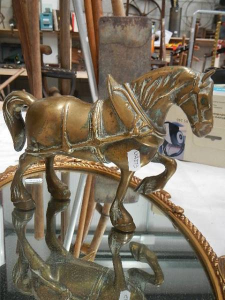 An oval cast mirror and a heavy cast brass horse. - Image 2 of 2