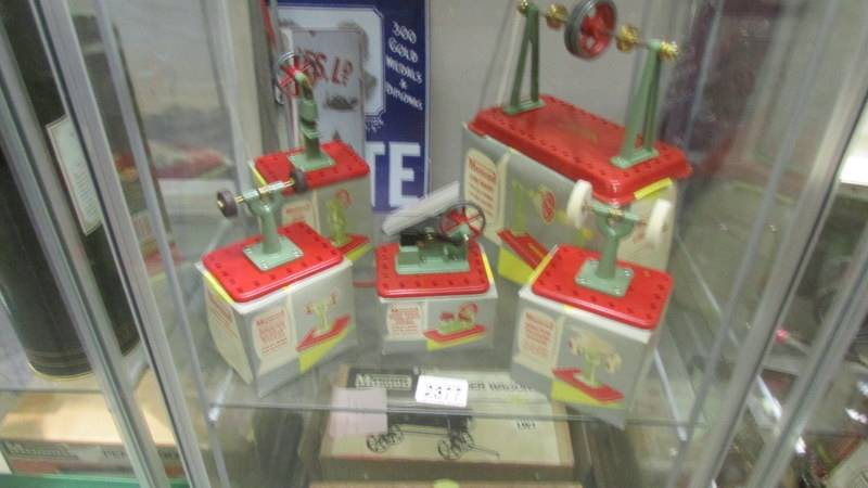 Five boxed Mamod steam engine accessories including power hammer, polisher etc.