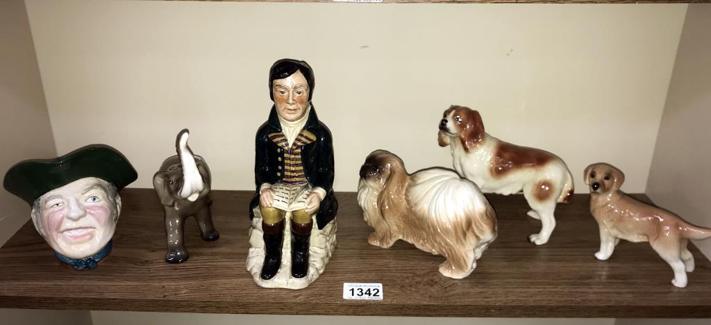 A selection of pottery dogs, Trentham elephant, Tony Wood & Robert Burns etc.
