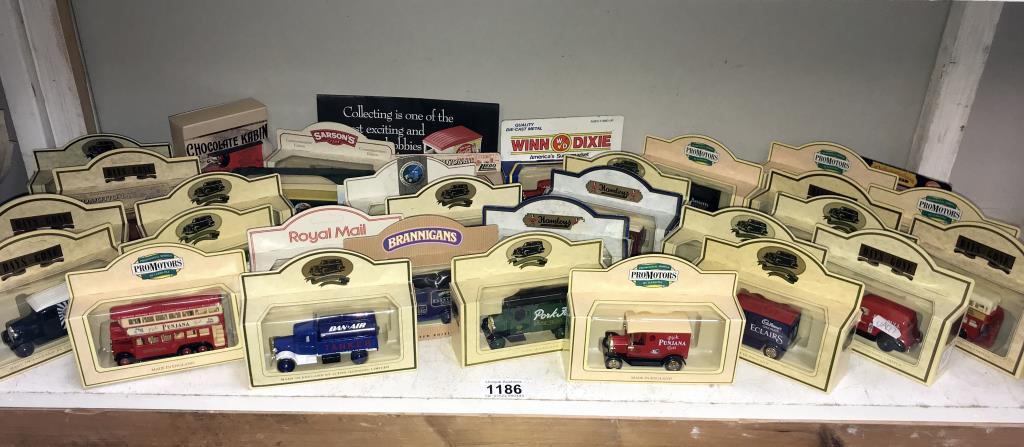 A selection of Lledo model vehicles including Golden shred & Cadburys etc.