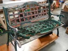 Two old cast garden benches in need of attention.
