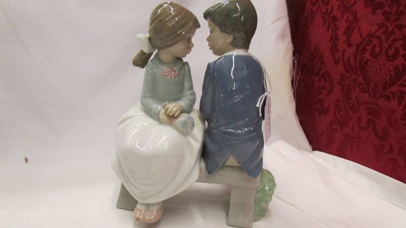 Two NAO figures - Girl with Flowers together with boy and girl on bench. - Image 5 of 6