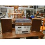 An Onkyo record deck, speakers, amplifier and a Rotek cassette.