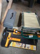 A tile cutter, new garden seat etc.