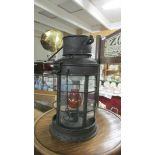 A vintage candle lantern converted to electric.