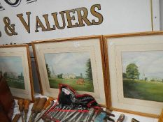 Three good framed and glazed watercolours of manor houses.