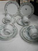 A twelve piece tea set.