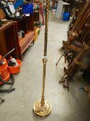 A brass standard lamp.