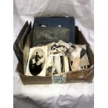 A box of old sepia photographs including albums & postcards
