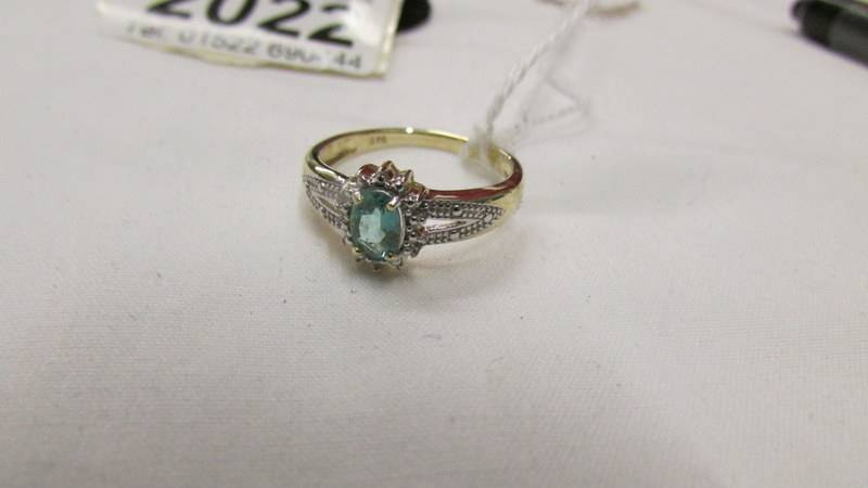 An oval emerald and diamond yellow gold ring, size M half. - Image 2 of 2
