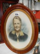 A 1920's portrait of an old lady in oval frame.