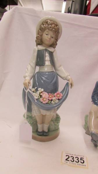 Two NAO figures - Girl with Flowers together with boy and girl on bench. - Image 2 of 6