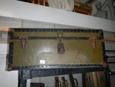A good quality but well travelled cabin trunk.