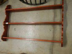 A mahogany wall shelf unit.
