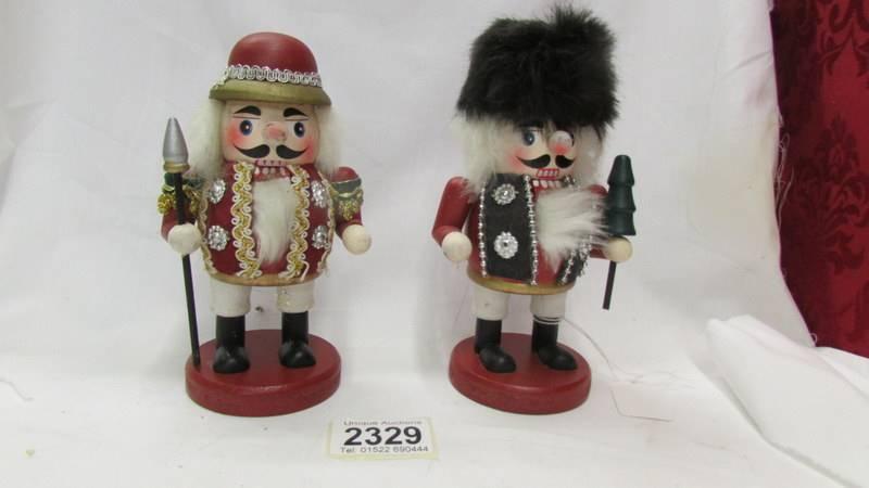 Two nutcracker dolls.