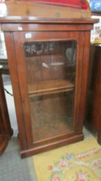 A mahogany glazed cabinet.