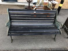 An early 20th century cast iron and wooden garden bench,