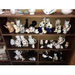 A large collection of cat figures