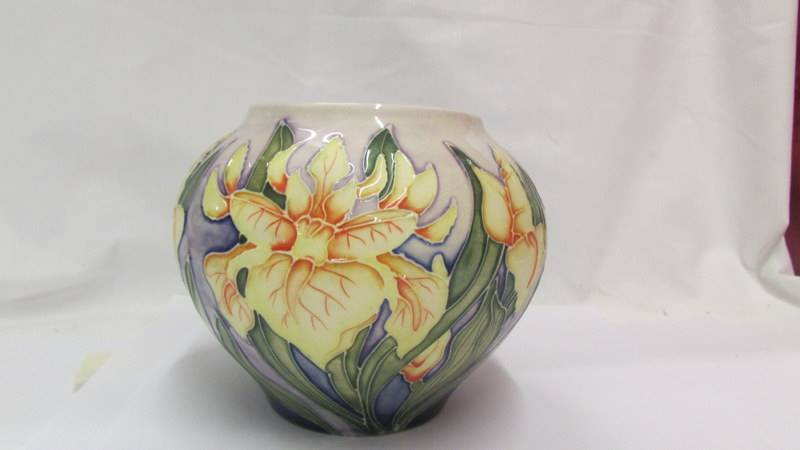 A Moorcroft small bulbous floral design vase (second). - Image 2 of 4