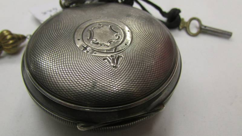 A silver pocket watch marked Fattorini & Sons, Bradford. - Image 2 of 2