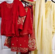 Various outfits including a soft yellow Punjabi suit (tunic and draped trousers),