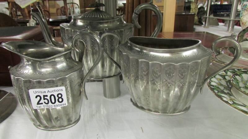 A three piece silver plate tea set.