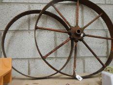 Two cast metal wheels.