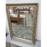 A gilt framed mirror. 61 x 87 cm.