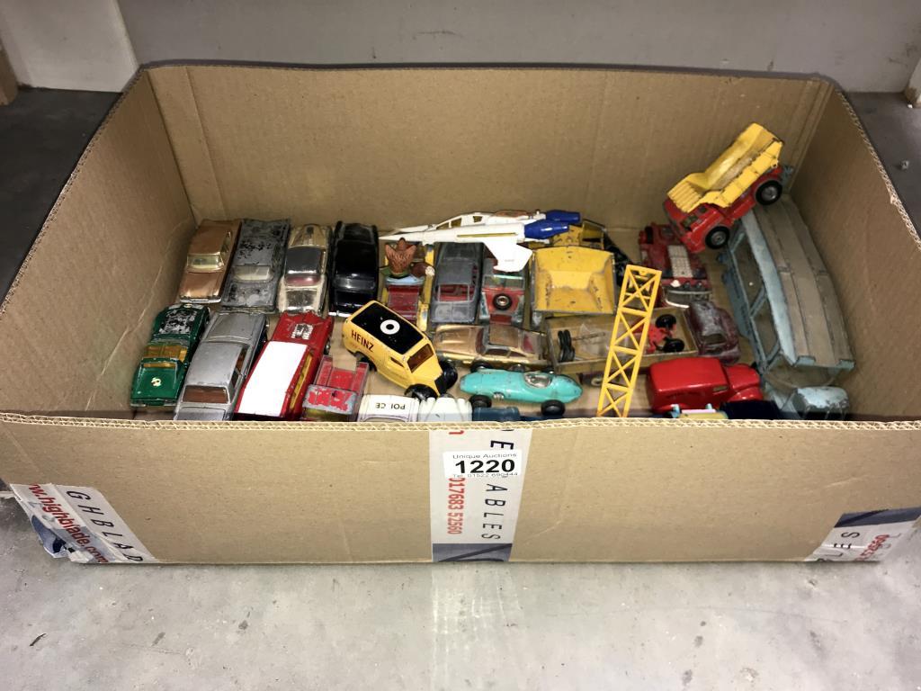 A large box of play worn Dinky & Corgi Die cast vehicles